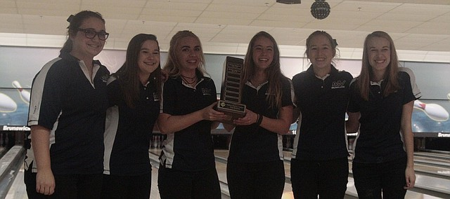 The Mill Valley girls bowling team stands with the Eastern Kansas League trophy after finishing first in its first EKL tournament on Tuesday at Olathe Lanes East. The Mill Valley boys also won to complete the league tournament sweep for the Jaguars. Pictured left to right: Meghan Clark, Bri Laluk, Abby Berner, Emily Jackson, Lauren Tracht and Raya Lehan.