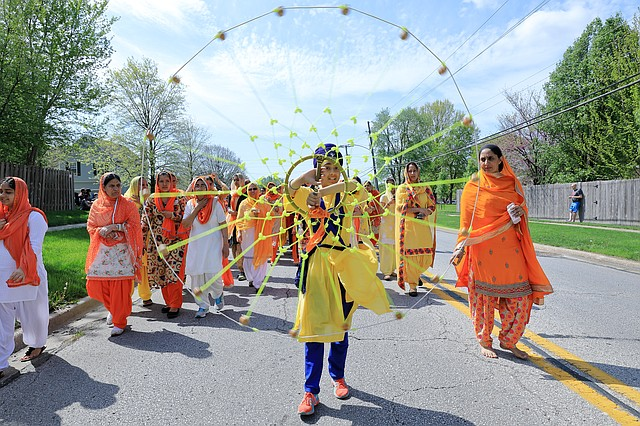 A boy spins a ceremonial chakkar during the Vaisakhi Parade. The festival celebrates the religion's new year.