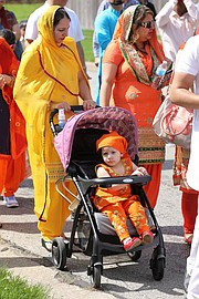People of all ages participated in the parade. Many families flocked to the festival following the precession.