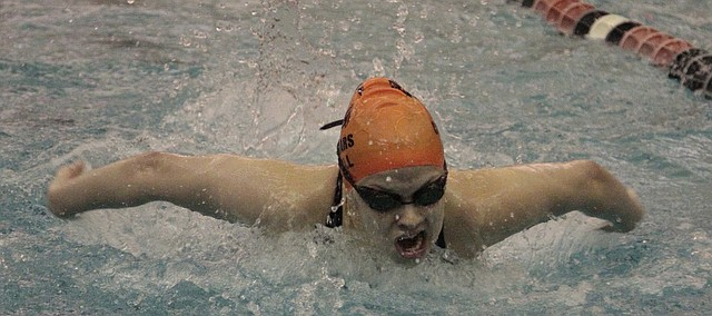 Shawnee Mission Northwest senior Hailey Brull swims to a first-place finish in the 100-yard butterfly at the Sunflower League meet on Saturday.