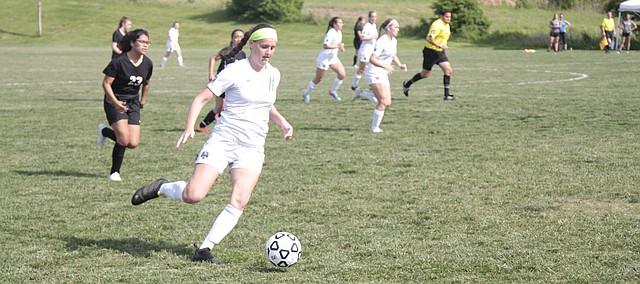 Maranatha Christian Academy senior Kayla Crowder dribbles the ball in the midfield during the Eagles' 14-0 win over Bishop Ward on Monday in the Class 4-1A regional semifinals. Crowder led the Eagles with five goals.