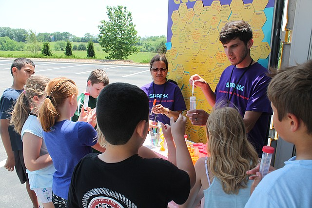 "Employees from the MilliporeSigma Lenexa campus volunteered their time to help kids learn fun hands-on experiments at the global company's ""Curiosity Cube"" mobile science lab, which made a stop at Belmont Elementary in Shawnee earlier this month."