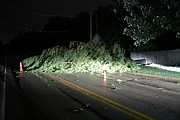 A large Cedar tree fell onto Midland Drive just west of Red Oak Drive during the storms. The tree blocked all three lanes of Midland Drive.