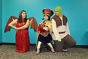 Katie Kaminski, left, Griffin Leander, center, and Matt Robison, right, pose in their costumes for the upcoming production of Shrek. They are a few of nearly 70 kids participating in the two Shrek shows this weekend and next weekend.