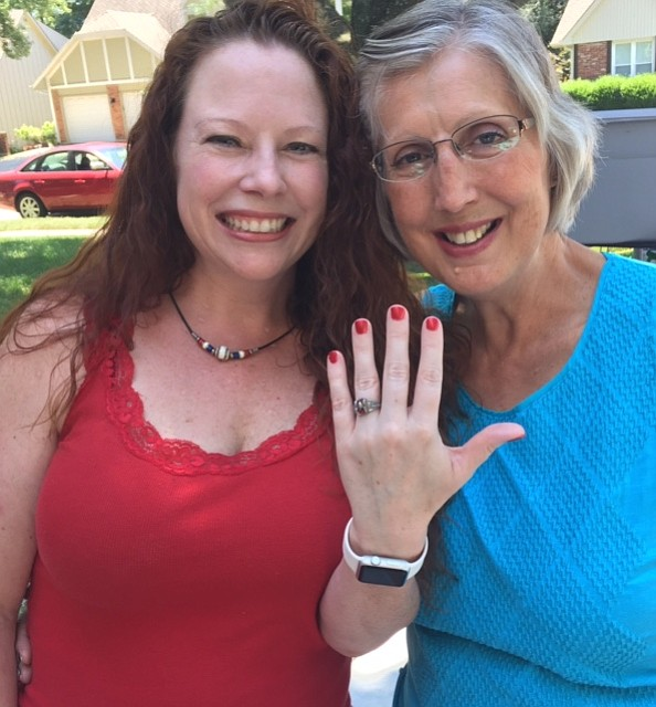 Kay Durham of Shawnee (right) reunited Jules Merckling of Liberty with her class ring lost 20 years ago.