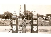 "William ""Al-Babe"" Donovan stands at the gas pumps in this family photo. The empty field behind Donovan is now a shopping center. Donovan's Service, 5912 Nieman Road, was founded in 1937."