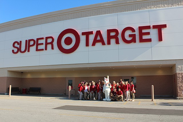 Target mascot BullsEye poses with the Shawnee Target staff after the store's ribbon-cutting ceremony to celebrate the store's recent renovation.