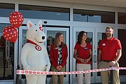 Above photo: Bulls Eye, left, prepares to help cut the ribbon with Target team leader Laura Boulware, Shawnee Mayor Michelle Distler, and Kolby Rosengreen, the Target team leader of remodel.