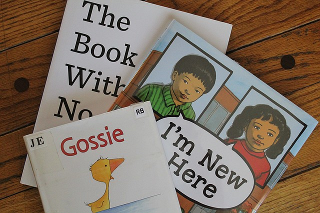 """The Book with no Pictures,"" by BJ Novak, ""I'm New Here,"" by Anne Sibley O'Brien and ""Gossie,"" by Olivier Dunrea are just a handful of the books Valdez has read to her students online."