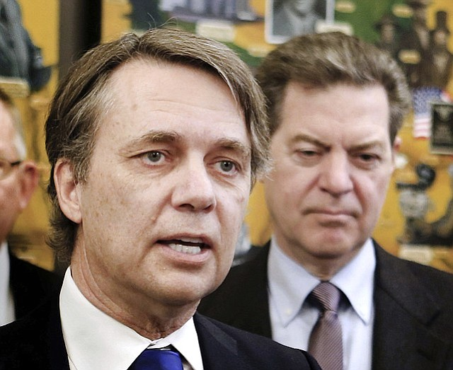 In this March 9, 2017, file photo, Kansas Lt. Gov. Jeff Colyer, left, and Gov. Sam Brownback participate in a humanitarian award ceremony at the statehouse in Topeka, Kan. (Thad Allton/Topeka Capital-Journal via AP, File)