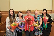 From left to right are help center staff Satchel Biron, Lacy Lindley, Teresa Young, Kerry O'Brien and Cecilia Yarick.