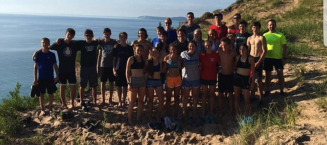 The De Soto cross country team poses for a photo during their trip from earlier in the summer to Onekama, Mich.