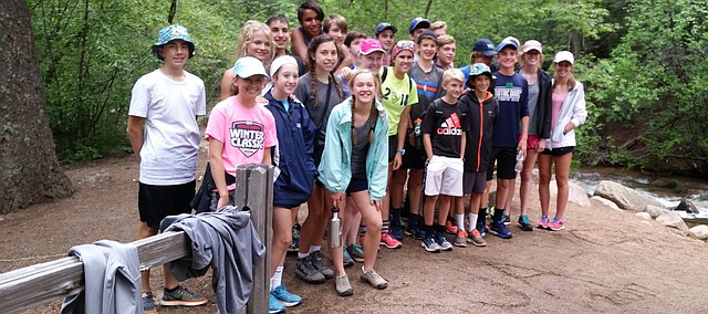 The St. James Academy cross country team stops for a group photo during a hike on their annual trip to Colorado Springs, Colo.