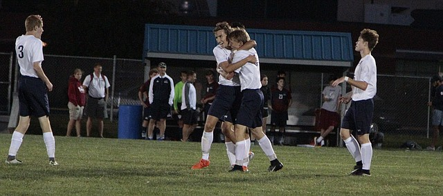 Mill Valley sophomore Ian Carroll receives a hug from junior Jake Ashford after his second goal in the Jaguars' 2-0 win over St. James Academy on Tuesday.