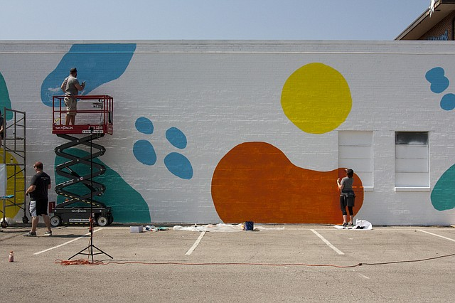 VML employees paint a mural at Wonderscope.