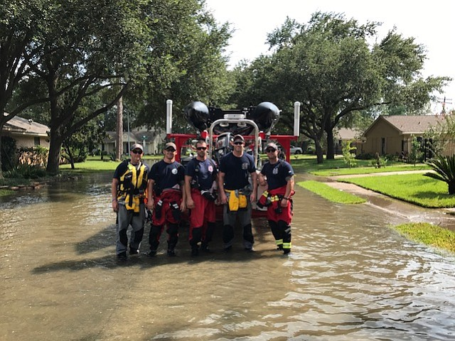 Standing in the flood of Hurricane Harvey, from left to right, are Shawnee firefighters Josh Chaney, Luke Lohmeyer, Cory Gearin, Matt Griffin, and Nate Schmidt.