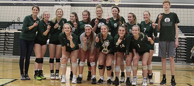The De Soto volleyball team poses for a photo after defeating Lansing in the championship match of the Spikefest tournament on Saturday at DHS.