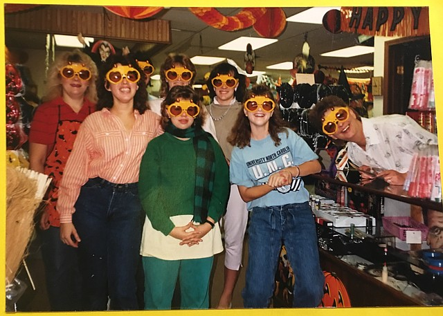 Employees of Fun Party & Wedding Services cheerfully pose in this 1985 snapshot.