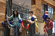 Shawnee Mission high school students tied ribbons to the CAA balcony during the grand opening ceremony.