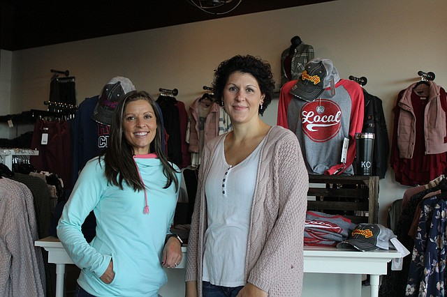 Amy Sharp, left, and Erin Thom, right, recently opened their boutique, Pink Charming, in western Shawnee.