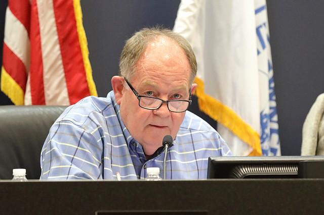Planning Commission chairman Dennis Busby listens to city staff address Westbrooke issues at the Nov. 6 meeting.
