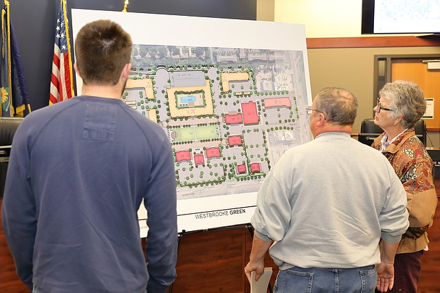 Residents observe the design layout for the upcoming Westbrooke Green project.