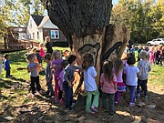 Christots Montessori School students admire the finished carved creations last week.