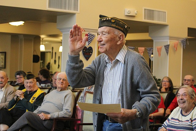 World War II veteran Marvin Brown thanks Shawnee Hills staff after receiving his Veterans Day certificate on Friday morning