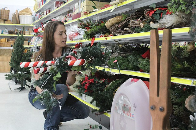 Shawnee City Thrift store manager Shandy Helm organizes Christmas decorations on Nov. 17. The new retail store, 11225 Shawnee Mission Parkway, celebrates its grand opening at 9 a.m. on Thursday, with a ribbon-cutting scheduled for 8:30 a.m.