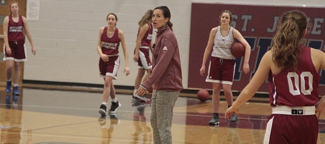 St. James girls basketball coach Samantha O'Malley observes during practice on Nov. 21.