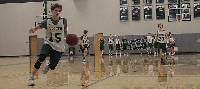 De Soto senior Jared Baruth goes in for a layup during practice on Nov. 16.