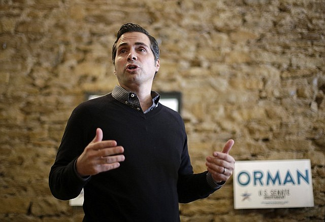 In this file photo from Nov. 1, 2014, Greg Orman talks to supporters during a senate campaign event in Topeka.