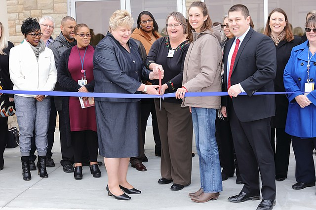 Kansas City VA Medical Center executives and staff, as well as Shawnee city officials, cut the ribbon for the new Shawnee VA medical center on Friday.