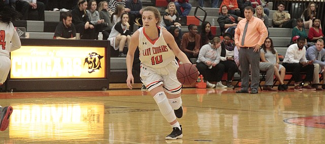 Shawnee Mission Northwest junior Rachel Seibold dribbles the ball on the perimeter in the first half of the Cougars' 47-31 win over SM North on Tuesday.
