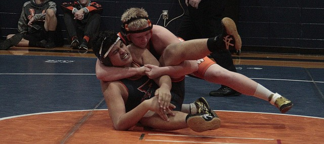 Shawnee Mission Northwest's Will Heitman maintains control in the second period of his match against Olathe East's Frankie Ross on Wednesday. Heitman pinned Ross in the third period, but the Hawks edged the Cougars, 42-33, to win the dual.