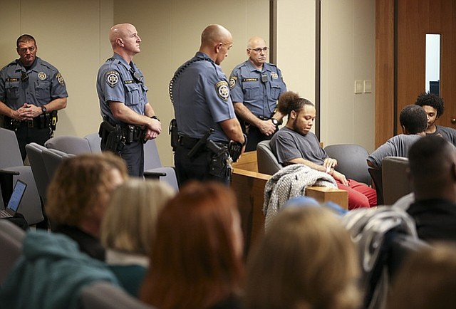 Image result for police officer stands beside testifying witness