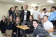 Bestselling author Gillian Flynn, center, poses with her former English teacher Craig Ewing and students from St. Thomas Aquinas High School in Overland Park.
