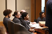From left, defendants Anthony L. Roberts Jr., Ahmad M. Rayton and Dominique J. McMillon listen to testimony, Friday, Jan. 19, 2018, during the second day of a preliminary hearing for charges related to an October 2017 triple homicide on Massachusetts Street.
