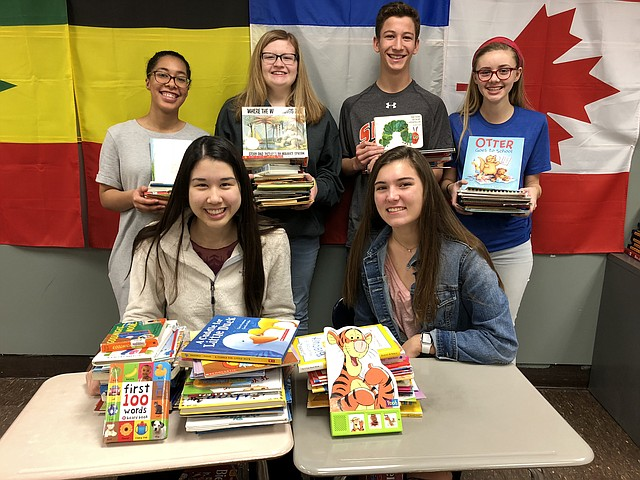 The Shawnee Mission Northwest High SchooL French National Honor Society chapter gathers recently to collect books for a family of refugees in the Congo. Seated, from left, are Rachel Tao and Caroline Sanders;  standing, from left, are Rachel Albright, Lauren Spear, Henry Tomasic and Mabel Anstine. Not pictured: Jackson Burnett