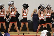 The Shawnee Mission Northwest High School drill team performed at the Golden Globes pep rally at Shawanoe Elementary School on Friday afternoon.