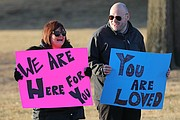 About a dozen sign-wielding community members lined 67th Street near the main entrance to the high school on Thursday morning.