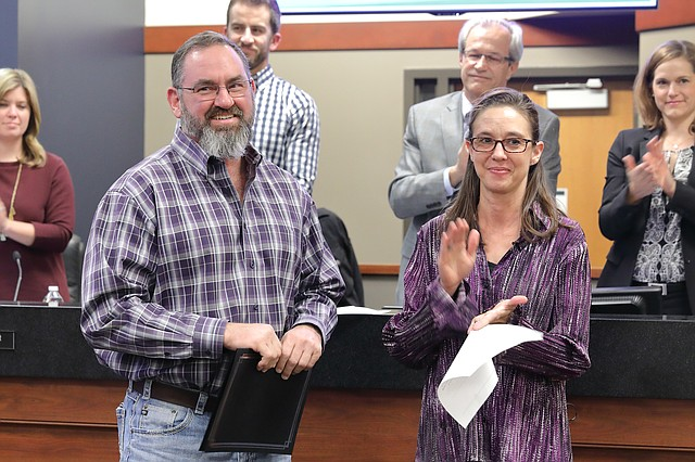 Shawnee Mayor Michelle Distler honored resident Craig Christopher for his bravery in saving a family from its home during a late night fire in December.