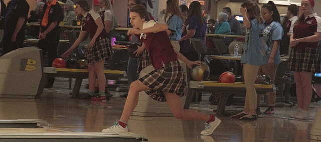 St. James Academy senior Meredith Bierbaum warms up during the practice time at Monday's triangular at Park Lanes. Bierbaum won the triangular with a 523 series and led the Thunder to first place.