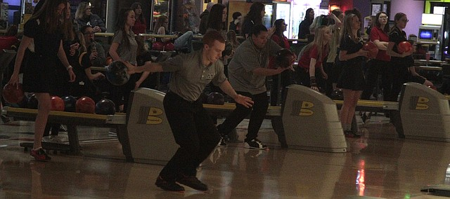 Mill Valley bowlers Clark Harris, left, and Bri Davis, right, warm up during the practice session of Tuesday's meet at Park Lanes.
