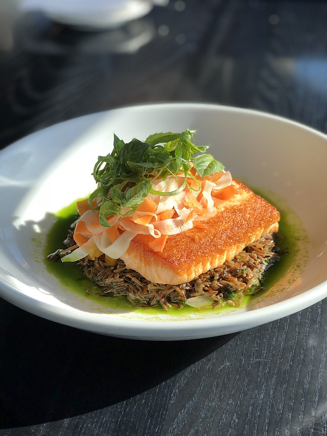 Pan Roasted Salmon, whole grain risotto, roasted yellow beets, fennel carrot salad, with a broken lemon herb vinaigrette. This dish is featured at Grand Street Café at the Plaza and Lenexa locations.