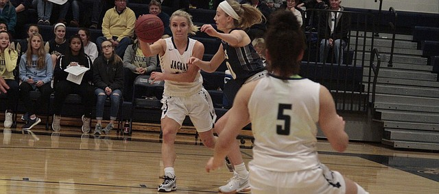 Mill Valley senior Adde Hinkle looks to pass to junior Presley Barton during the first half of the Jaguars' 47-36 loss to St. Thomas Aquinas on Friday.