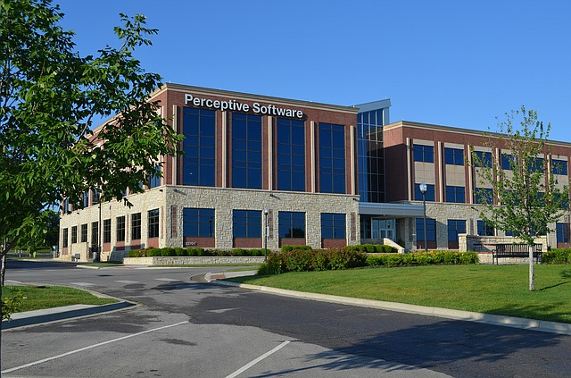The former Perceptive Software building in western Shawnee goes up for auction on Feb. 26.