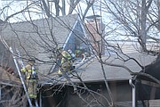 Firefighters used chainsaws and axes to access the attic space and extinguish hotspots.