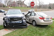 Two vehicles ended up in a yard after crashing in the intersection of 71st Street and Pflumm Road early Friday evening.