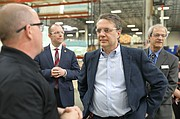 Colyer learns about the complexities behind mattress-making during a special tour of the Serta Simmons Bedding plant in western Shawnee.